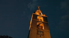 An old chapel highlighted by yellow lights Stock Footage