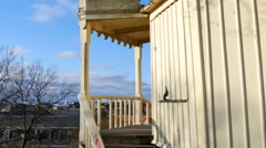 Old yellow wodden pavilion in Helsingborg with a nice view over the city Stock Footage