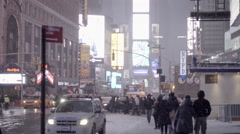 Snowing in Times Square street at night in winter - 4K in New York City Stock Footage