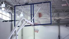 Basketball. Baller throw the ball. The ball bounces off the glass into the hoop Stock Footage