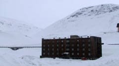 View to the buildings of the Russian arctic settlement Barentsburg, Norway. Stock Footage
