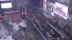 Panning across window view looking down on Times Square in winter traffic NYC Stock Footage