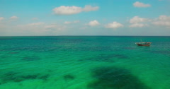 Aerial view Flying camera over Sea and boat stops at the end. Bird eye view. - stock footage