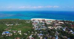 Aerial view Flying camera over buildings and Beach. Zanzibar. Bird eye view. - stock footage