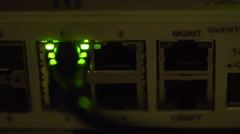 ethernet switch traffic light blinking in a dimly lit server room 4k - stock footage