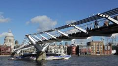 St Pauls Cathedral with tourists crossing the Millennium Bridge  - stock footage