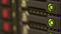 Shallow depth of field hard drive lights blinking on a server Stock Footage
