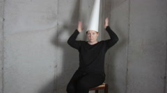 Woman in Dunce Cap Making Faces Stock Footage