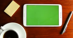 Top view green screen tablet pc finger actions and gestures on wooden desk - stock footage