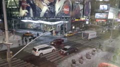 elevated view 42nd Street 8th ave Times Square traffic at night - snowing in NYC - stock footage