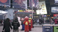 street performers costume snowing winter corner Times Square taking break NYC - stock footage