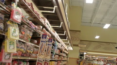 Moving through the bread aisles of a large grocery store Stock Footage