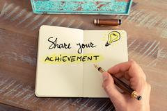 Handwritten text SHARE YOUR ACHIEVEMENT - stock photo
