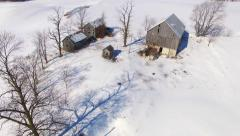 Scenic Winter flyover of abandoned, rustic homestead farm buildings Stock Footage