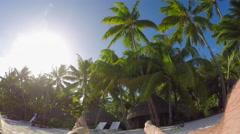 Man enjoying vacation on sunny beach at luxury hotel resort Stock Footage