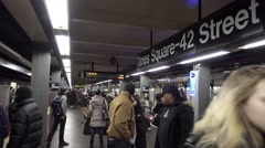 Times Square 42nd st sign subway station platform with passengers in NYC Stock Footage