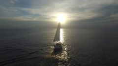 Flying around sailing yacht in the ocean Stock Footage