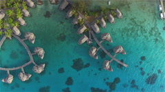 AERIAL: Flying above luxury overwater bungalow villas at hotel resort - stock footage