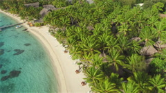 AERIAL: Flying above beautiful white sandy beach on exotic island Stock Footage