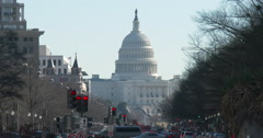 United States Capitol Building seen in the distance from intersection 4k Stock Footage