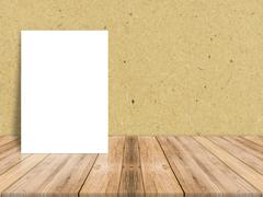 Blank white paper poster at tropical plank wooden floor and paper wall Stock Photos