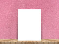 Blank white paper poster at tropical plank wooden floor and paper wall - stock photo