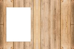 Blank folded paper poster hanging on wooden wall,Template mock up for adding - stock photo