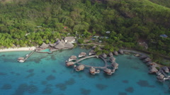 AERIAL: Flying around exotic island hotel resort in Bora Bora - stock footage