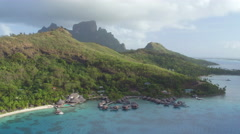 AERIAL: Flying towards luxury hotel resort in Bora Bora island Stock Footage