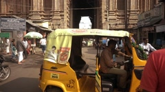 Busy street with temple in India. Tilting shot. Stock Footage