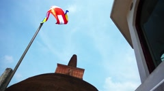 Look up at the buddhist flag on pole fluttering in the wind Stock Footage