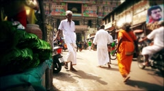 Busy street in India. Slow-motion slide shot. Stock Footage