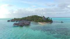 AERIAL: Luxurious private island resort with overwater bungalow villas - stock footage