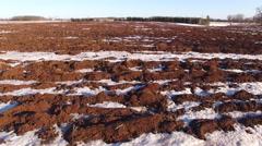 Farm fields lie dormant in winter, but spring is near - stock footage
