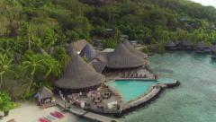 AERIAL: Luxury oceanfront hotel resort on tropical white sandy beach - stock footage