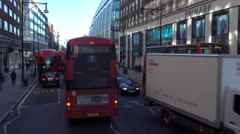 London England narrow road double decker buses 4K Stock Footage