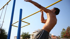 Man doing a One Arm Pull Ups Stock Footage