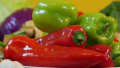 Red and green peppers, close up, vegetables,dolly,tracking shot on left - stock footage