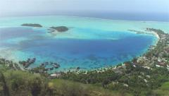 AERIAL: Panoramic views of luxury hotel resorts with overwater villas - stock footage