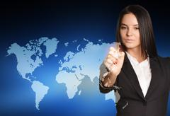 Woman in suit drawing on world map virtual space Kuvituskuvat