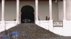 Pilgrims on the church's entrance Stock Footage