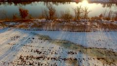 Approaching the river's edge at daybreak Stock Footage