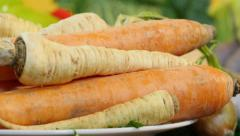 Carrots and horseradish close up, vegetables on table, dolly on left. Stock Footage