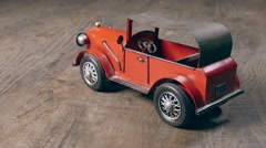 Retro metal toy car over wooden table. Retro style. Dolly shot. Stock Footage
