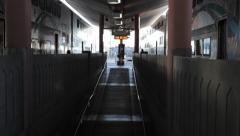 Passengers running to metrolink train in Union Station LA terminal Stock Footage