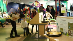 Kids with parents visiting an educational cognitive museum Stock Footage