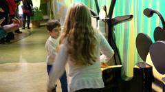 Kids playing trying stands in educational cognitive museum for children Stock Footage
