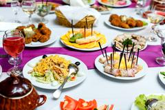 Appetizers and salads at the banquet table Stock Photos