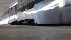 Amtrak metrolink train leaving Union Station terminal seen from ground Stock Footage