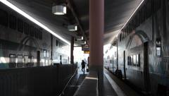 Passengers walking to amtrak metrolink train in Union Station terminal Stock Footage